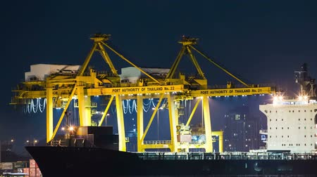 shipping : Time Lapse Cargo ship loading goods at shipping port, High quality at night. Stock Footage