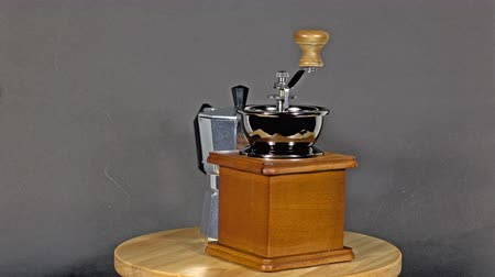 descafeinado : Coffee grinders, vintage coffee boilers  on a wooden  is rotating show Vídeos