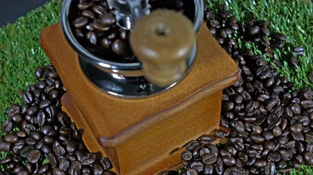 descafeinado : Coffee grinders vintage and coffee beans  on a grass is rotating show