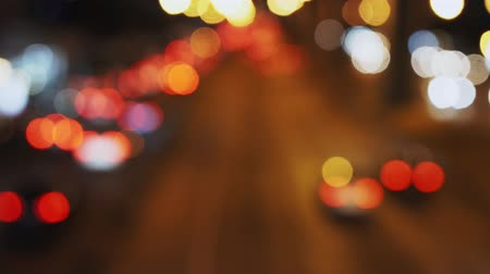 defocus : Image of background defocusing the light car at night. 4K Stock Footage