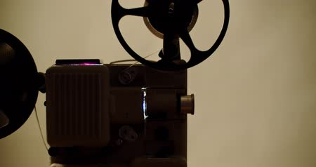 8 mm movie projector Retro is playing. Vintage projector, 4K DCI