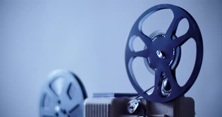 8 mm movie projector retro is playing. Vintage projector, blue color 4K DCI