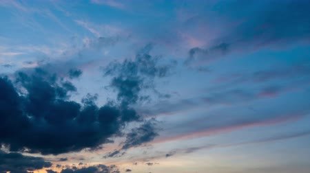 sztratoszféra : time-lapse 4K sunset cloud moving away from the abstract colorful background