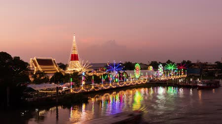 TIMELAPSE : The annual festival of the temple in Samut Prakan province has brightly decorated lights in Thailand. 4K