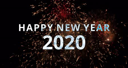 The real fireworks celebration colorful sky in the background black and the text Happy New Year 2020. 4K DCI