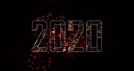 The real fireworks celebration colorful sky in the background black and the text New Year 2020. 4K DCI