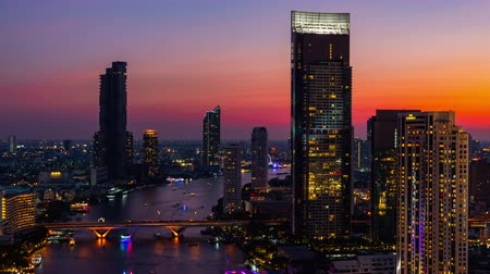 An aerial view of  Bangkok cityscape including Chao Phraya River during night time, Time lapse 4K