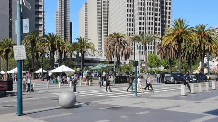 embarcadero : SAN FRANCISCO, USA - APRIL 9, 2014: People visit downtown San Francisco, USA. San Francisco is the 4th most populous city in California (837,442 people in 2013).
