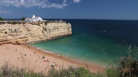 promontory : Algarve, Portugal - Senhora da Rocha Beach with white chapel. Lagoa municipality. Stock Footage