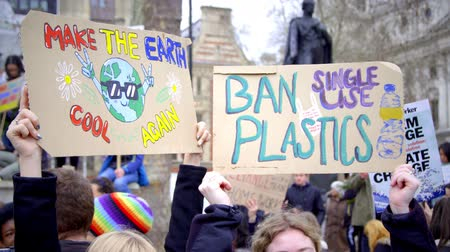 London, UK - October 12th, 2019 : Climate Change and Plastics Protest Signs, Hands holding up signs protesting climate change and calling for the ban of single use plastics in London, UK.