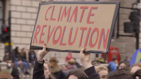 emissions : London, UK - October 12th, 2019 : Climate Revolution Protest Sign, Protester holding climate revolution sign, marching through London.