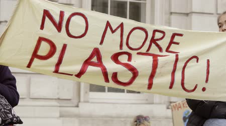 London, UK - October 12th, 2019 : No More Plastic Protest Banner, Close up of a banner reading No More Plastic! at a protest in London, UK. Стоковые видеозаписи
