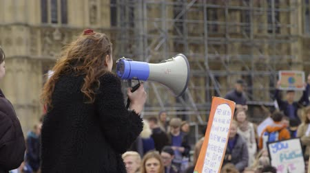 London, UK - October 12th, 2019 : Young Protester Using Megaphone, Protester using megaphone outside the UK Parliament, London.