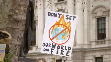 London, UK - October 12th, 2019 : Dont Set Our World on Fire Protest Sign, Close up of a sign reading Dont Set Out World on Fire at a climate change protest in London, UK.