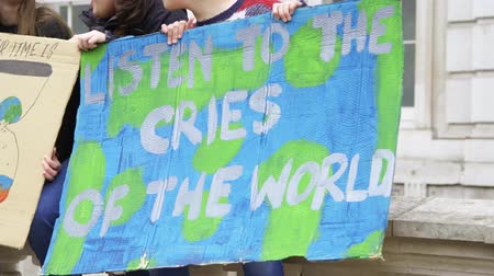 London, UK - October 12th, 2019 : Listen To the Cries of the World Protest Sign, Close up of a sign reading Listen to the Cries of the World at a protest in London, UK.