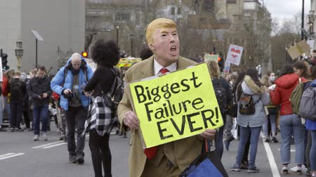 London, UK - October 12th, 2019 : Climate Protester in Trump Mask, Climate change activist dressed as Donald Trump holding a sign reading Biggest Failure Ever!