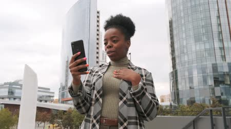 A Woman In A Video Call Outside Of A Building