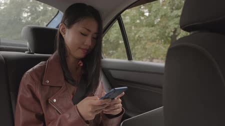 Woman Sitting In A Car While Texting