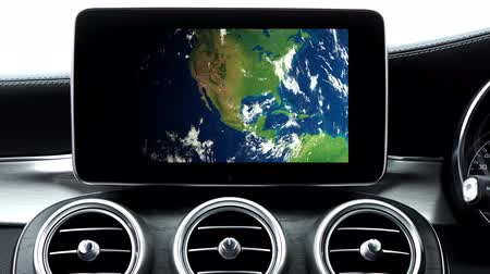 Car Interior And GPS Navigation Device Showing Earth