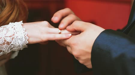ring : Two white people groom and bride exchange wedding rings