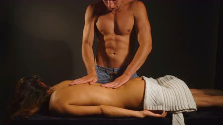 smyslnost : massage and relaxation, passion and lust, young sexy couple pretty girl with long hair and slim body seduce handsome man with naked torso.