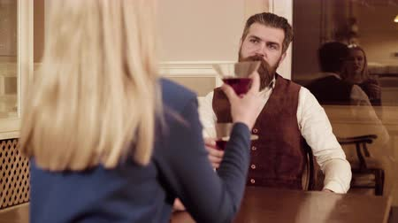 szminka : Couple in love. Handsome man flirting with cute woman in restaurant. Bearded man flirting with young sexy blonde Wideo