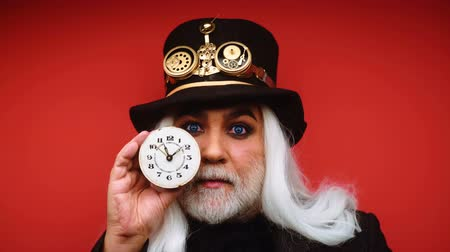 czarodziej : Watchmaker, time keeper, time line. Time wizard. Old man with watch. Time is money