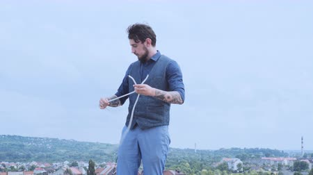 imaginário : Magician performing trick with rope. Magic performer illusionist, disappears and rises. Cord artist. Cabaret show or circus entertainment performance.