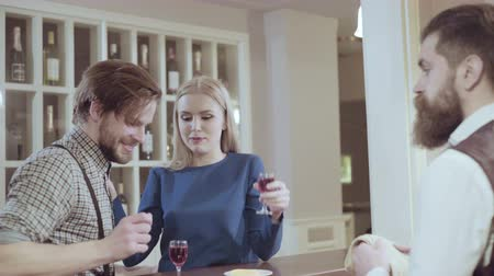 affluent : Attractive elegant young couple drinking a cocktail at the restaurant. Handsome loving couple flirting in a cafe. Love and romance. Lifestyle concept Stock Footage