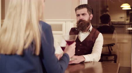 affluent : Couple in love. Handsome man flirting with cute woman in restaurant. Bearded man flirting with young sexy blonde Stock Footage