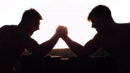 conflict : Two armwrestlers, have an arm wrestling match