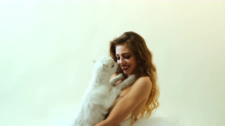 astroloji : Sensual woman with goat. Sexy blond girls with goat. Stok Video