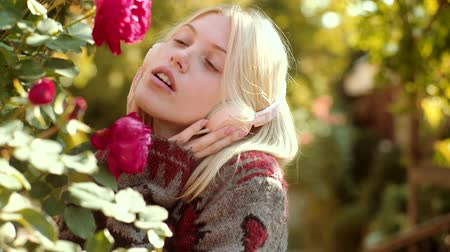 autumnal : Dreamy spring girl with long hair in knit sweater. Headphones concept. Autumn woman with spring mood. Autumn happy people and joy. Clouse up portrait of blonde girl.