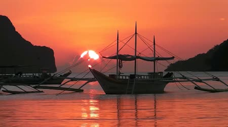 boat tour : Sunset on a tropical island. El Nido. Philippines. Stock Footage