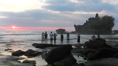 bratan : Sunset and sea surf near Tanah Lot Temple, Bali, Indonesia