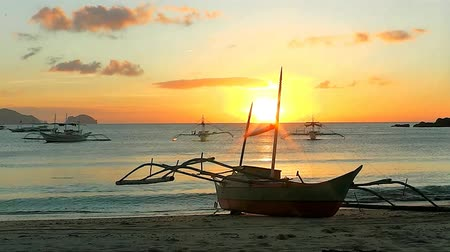 Sunset of Nacpan beach. The island of Palawan. Philippines.