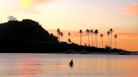 port n : Sunset of Nacpan beach. The island of Palawan. Philippines.