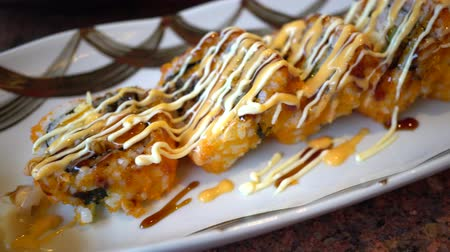 gunkan : Top view of California sushi roll served on the plate, using video panning technique