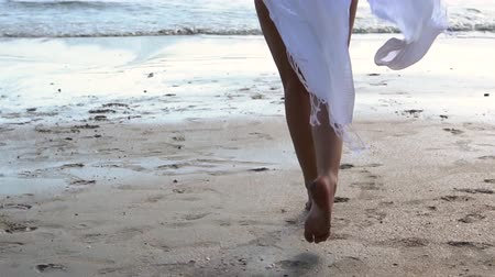 white cloths : Low angle view of young woman running towards the sea ocean with happy mood. Stock Footage