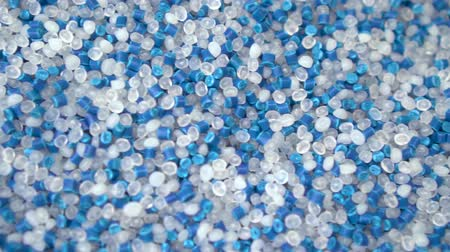 injetar : Virgin plastic pellets with blue pigment pellets. Plastic Material for molding machine and plastic injection machine. Industrial engineering concept Stock Footage