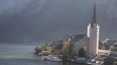 Landscape video of Hallstatt lake with the Hallstatt Lutheran Church under renovation in day time 動画素材
