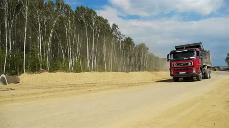 truck stop : Red truck goes by Stock Footage