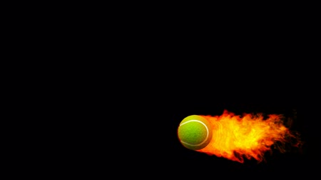 tennis game : Tennis fireball in flames on black background  Stock Footage