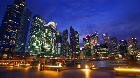 time lapse clouds : Sunset at Marina bay quay in Singapore Stock Footage