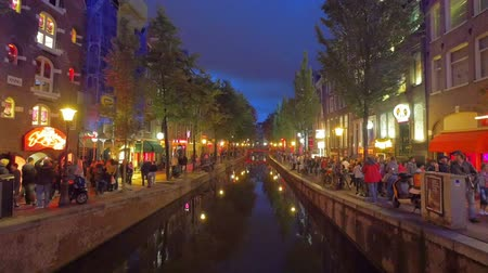 Crowds of people in Red light district Amsterdam Holland.