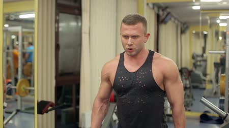 retouched : Fit muscular man exercising with dumbbell. Stock Footage