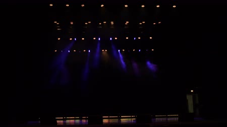nagy felbontású : Flashing concert light in an empty theater. Free stage with lights. Stage lights. 4k Stock mozgókép