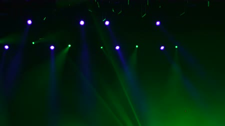 nagy felbontású : Spotlight, a few points of light on stage. Blurred lights a rock concert. 4k