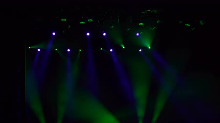 nagy felbontású : Blue and green light on stage. Checking concert lighting equipment before the concert. Stage lights.