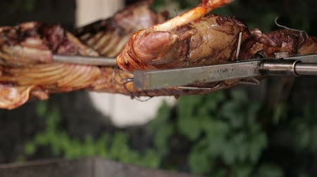 repast : The meat is fried on a grill on a spit. The ram is fried on a spit on an open fire in a restaurant.